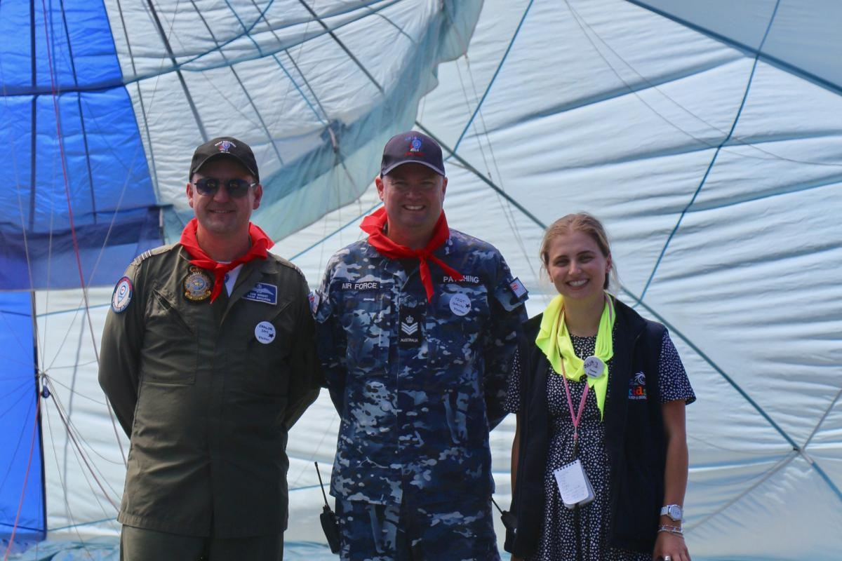 Air Force Balloon pilot SQNLDR Samuel Wright, Air Force Balloon ground crew FSGT Gavin Patching and Camp Leader Julia Psyhogios inside the Air Force Balloon inflate.