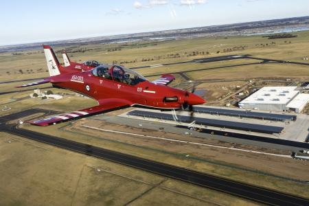 Pilatus PC-21 aircraft, A54-003 and A54-004 overfly the new flying training facilities