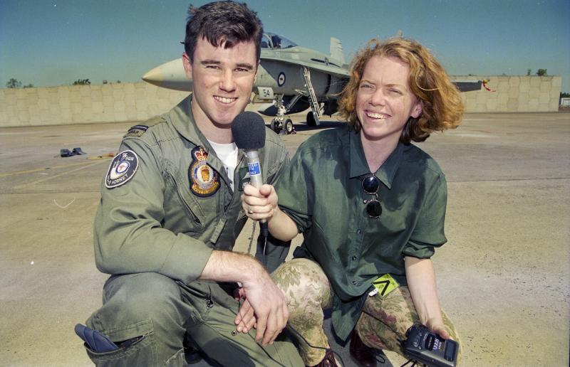 Flying Officer Matthew Hall, an F/A-18A Hornet pilot with No. 77 Squadron, speaks to a journalist